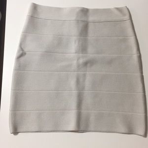 Bebe Gold Bandage Mini Skirt